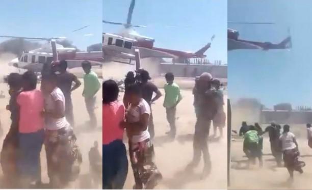Inhumano: les tiran comida desde un helicóptero y corren desesperados a buscarlos